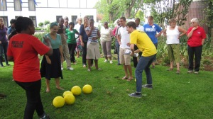 Grassroot soccer training -- pretending the balls are multiple partners, which makes it easier for a person (HIV) to come and tag me while I'm trying to dribble four at a time