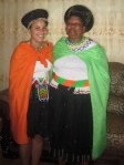 Mama and myself in traditional Zulu dress: isidwaba (made by my mom!), beads, and isicholo (traditional hat women wear)