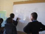 Using a white board for the first time; they were fascinated