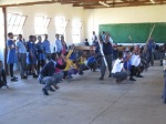 Bongani  teaching other learners how to do indlamu, a traditional Zulu dance