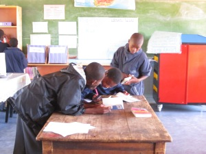 Spheamandla and other grade 7 learners checking out a book for the first time in their lives
