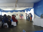 Grade 6 and 7 learners preforming a skit in English at the library opening ceremony